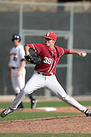 Jake Fisher (39) of the Oklahoma Sooners pitches against the Pepperdine Waves at Eddy D. Field Stadium on February 18, 2012 in Malibu,California. Pepperdine defeated Oklahoma 10-0.(Larry Goren/Four Seam Images)