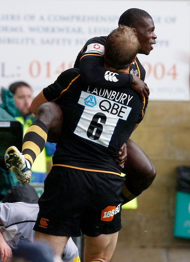Photo: Richard Lane/Richard Lane Photography. London Wasps v Leicester Tigers. 11/09/2011. Wasps' Christian Wade celebrates his third try with Joe Launchbury.