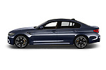 Car driver side profile view of a 2018 BMW M5 Base 4 Door Sedan