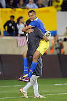 Eduardo Morante (2) of Ecuador celebrates with goalkeeper Maximo Banguera (1) at the end of the game. The men's national team of the United States (USA) was defeated by Ecuador (ECU) 1-0 during an international friendly at Red Bull Arena in Harrison, NJ, on October 11, 2011.