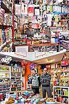 DI TUTTO DI PIU'<br /> Lo spaccio di Hamid Louni<br /> La cartoleria Peter Pan<br /> <br /> Sperso tra le merci<br /> serio l&rsquo;uomo sta a controllare<br /> a riempire gli angoli,<br /> a stipare.<br /> Sembra il negozio dei cartolai<br /> dove di tutto<br /> - pi&ugrave; giocattoli meno quaderni-<br /> puoi trovare.<br /> <br /> Pi&ugrave; giocattoli<br /> meno quaderni<br /> pi&ugrave; tigri<br /> meno penne,<br /> scaffali riempiti con garbo<br /> e le luci lass&ugrave;, in disparte, senza disturbare.<br /> C&rsquo;&egrave; chi sorride e chi no,<br /> chi s&rsquo;appoggia avanti chi indietro<br /> ma bene s&rsquo;incastrano i due cartolai:<br /> viola le righe e la maglietta<br /> grigio nero bianco mescolati<br /> coriandoli di vita diventati.