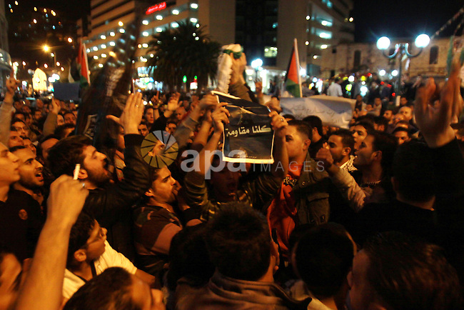Palestinian activists hold placards during a protest against the Israeli military operations in Gaza strip, in the West Bank city of Nablus on November 15, 2012. Several Palestinians were killed following a series of Israel's concurrent airstrikes on Gaza city, among them was Ahmed al-Jaabari, top commander of Hamas armed wing Al-Qassam brigades, and more than 150 others wounded, government's emergency services in the Gaza Strip said. Photo by Nedal Eshtayah