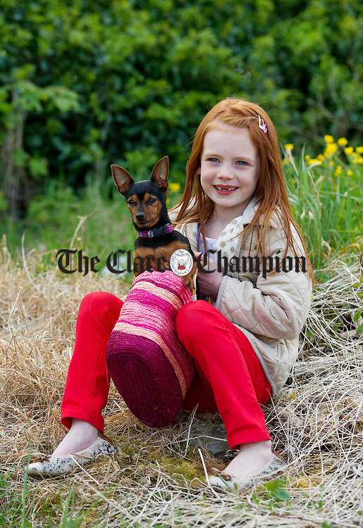 Katie Lee with her dog Roxy at the World Stone Throwing Championships in Corofin. Photograph by John Kelly.