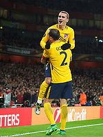Antoine Griezmann celebrates his goal with Diego Godín of Atletico Madrid during the UEFA Europa League Semi Final 1st leg match between Arsenal and Atletico Madrid at the Emirates Stadium, London, England on 26 April 2018. Photo by Andy Aleksiejczuk / PRiME Media Images