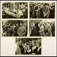BNPS.co.uk (01202 558833)<br /> Pic: ChalkwellAuctions/BNPS<br /> <br /> The carefully orchestrated pictures show the Fuhrer as a popular man of the people greeting adoring fans both young and old.<br /> <br /> Found in a cardboard box...a meticulous account ofthe pre war rise of the cult of Hitler.<br /> <br /> An incredible picture archive that charts the rise of Hitler believed to have been meticulously documented by a fan of the Fuhrer has emerged for sale.<br /> <br /> The collection of propaganda photographs show Adolf Hitler on a charm offensive in the 1920s and 30s - before the evil dictator started the Second World War and eliminated at least five million Jews in the Holocaust.<br /> <br /> Some of the images try to show a softer side to the Nazi leader, with him feeding a small deer and accepting a bouquet from a young girl.<br /> <br /> Others chillingly show the hype created around him - rows of people performing the straight-arm Nazi salute, a young boy beaming as Hitler signs an autograph for him and a group of girls giggling as they chat to the party leader.