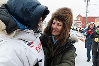 Jason Mackey gets a hug from his mom at the finish line in Nome on Thursday March 13 during the 2014 Iditarod Sled Dog Race.<br /> <br /> PHOTO (c) BY JEFF SCHULTZ/IditarodPhotos.com -- REPRODUCTION PROHIBITED WITHOUT PERMISSION