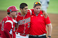 Batavia Muckdogs shortstop Alex Mejia #3 is helped to the cart by trainer Mike Petraca as manager Dann Bilardello #11 looks on after Mejia injured his knee while running through first base\during a game against the Staten Island Yankees at Dwyer Stadium on July 30, 2012 in Batavia, New York.  Batavia defeated Staten Island 5-4 in 11 innings.  (Mike Janes/Four Seam Images)