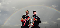 Lincoln City's assistant manager Nicky Cowley, left, and Lincoln City manager Danny Cowley pose for a photograph holding the Emirates FA Cup as a rainbow appears over Lincoln City's new Elite Performance Centre<br /> <br /> Photographer Chris Vaughan/CameraSport<br /> <br /> The official opening of Lincoln City's new Elite Performance Centre - Wednesday 7th November 2018 - Scampton, Lincolnshire<br /> <br /> World Copyright © 2018 CameraSport. All rights reserved. 43 Linden Ave. Countesthorpe. Leicester. England. LE8 5PG - Tel: +44 (0) 116 277 4147 - admin@camerasport.com - www.camerasport.com