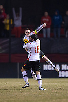 Taylor Kemp (2) of Maryland celebrates with teammate Dakota Edwards (18) after the game at Ludwig Field in College Park, MD.  Maryland defeated Louisville, 3-1.