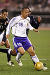 10 February 2006: Shinji Ono (18), of Japan, is pursued by Eddie Pope (r) and Clint Dempsey (l) of the United States. The United States Men's National Team defeated Japan 3-2 at SBC Park in San Francisco, California in an International Friendly soccer match.