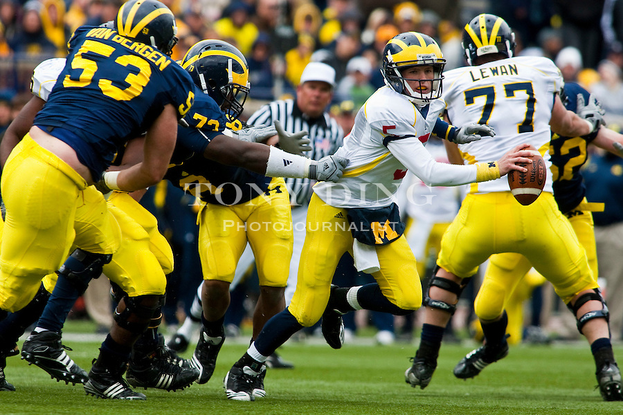 Michigan defensive tackle William Campbell (73) snatches a hold of quarterback Tate Forcier's (5) jersey during the Wolverines' spring football game, Saturday, April 17, 2010, in Ann Arbor, Mich. (AP Photo/Tony Ding)
