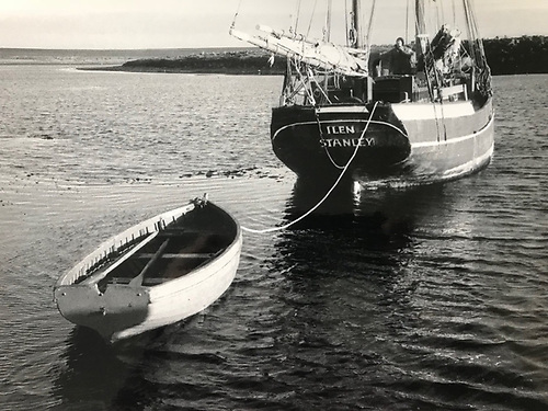 Ilen and her punt, with a float of kelp drifting past in classic Falklands style