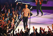 3rd February 2019, Atlanta Georgia, USA; NFL Superbowl LIII, New England Patriots versus Los Angeles Rams;  A shirtless Adam Levine performs during the Pepsi Halftime Show during Super Bowl LIIIwire)