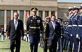 United States Secretary of Defense Donald H. Rumsfeld (left) and Commander of Troops Colonel Thomas M. Jordan (center), U.S. Army, escort King Abdullah II (right), of the Hashemite Kingdom of Jordan, as he inspects the honor guard during a Pentagon welcoming ceremony on April 5, 2001.  Accompanying the King is Prince Ali Bin al-Hussein, Chief of the Royal Guard. .Mandatory Credit: Helene Stikkel / DoD via CNP.