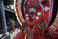 A Thayam at Atmachamayam (starting of Onam) a folk art form of Kerala. Tripurnithura near Ernakulam, Kerala, India.