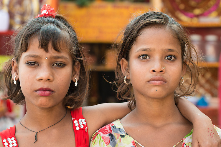 Young girls passing time in the big stairs facing the river in Varanasi-