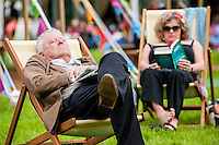 Hay on Wye, UK. Friday 27 May 2016<br /> People relax at the hay in the warm weather <br /> The 2016 Hay festival take place at Hay on Wye, Powys, Wales