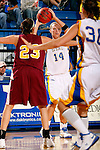 Kristen Rotert, a sophomore of South Dakota State, looks for an open teammate past Minnesota-Crookston defender Jamie Zelinsky during the first half of their game Tuesday evening at Frost Arena on the campus of South Dakota State University in Brookings, SD. (Photo By Ty Carlson/Inertia)