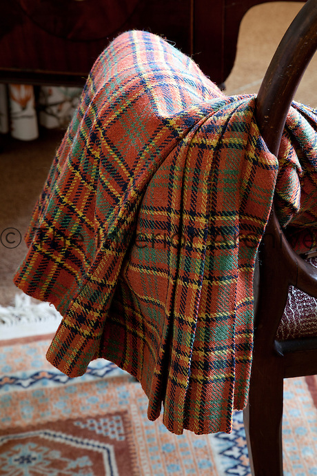 Another type of Munro tartan which is woven of different hues of red, yellow and green