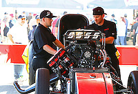 Feb 8, 2015; Pomona, CA, USA; Crew members working in the pit of NHRA funny car driver Cruz Pedregon during the Winternationals at Auto Club Raceway at Pomona. Mandatory Credit: Mark J. Rebilas-