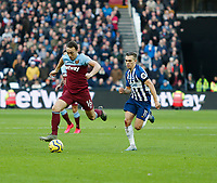 1st February 2020; London Stadium, London, England; English Premier League Football, West Ham United versus Brighton and Hove Albion; Mark Noble  of West Ham United gets away from Leandro Trossard of Brighton and Hove Albion