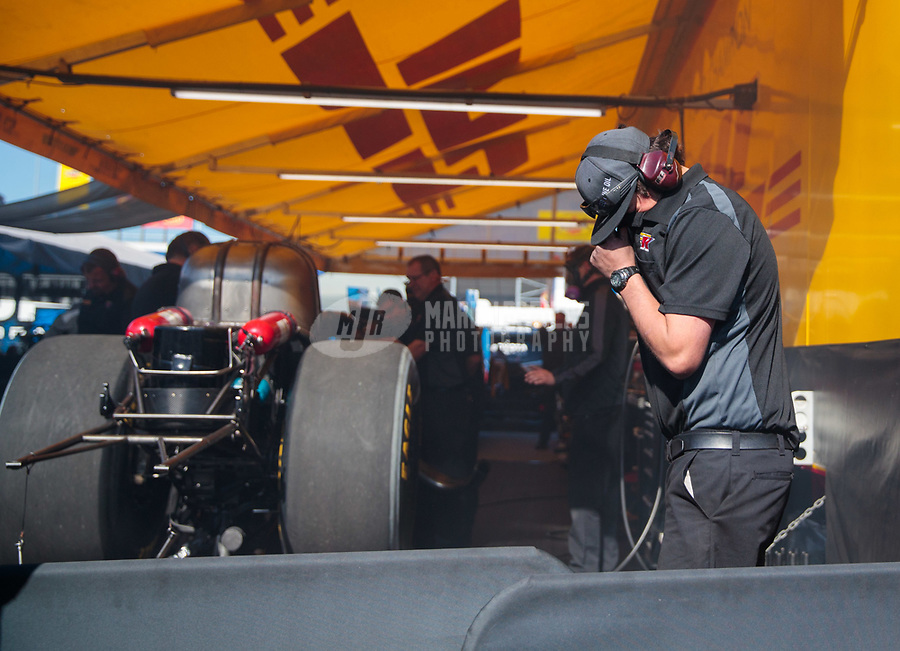 Apr 14, 2019; Baytown, TX, USA; Crew member for NHRA funny car driver J.R. Todd during the Springnationals at Houston Raceway Park. Mandatory Credit: Mark J. Rebilas-USA TODAY Sports