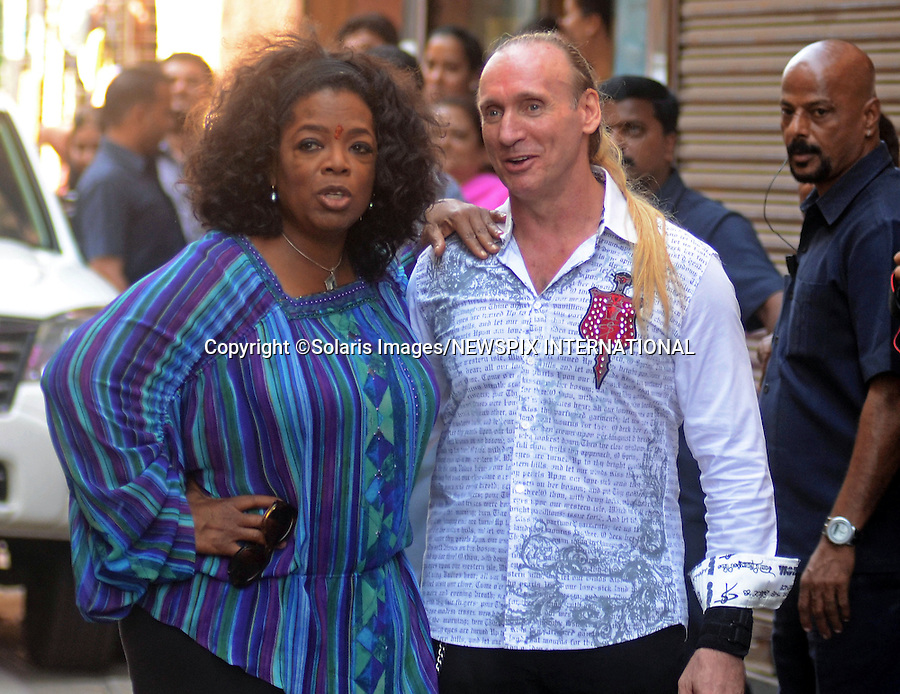 "Mumbai,India-17/01/2012: OPRAH WINFREY IN INDIA.American talk show hostess Oprah Winfrey with author Gregory Roberts (Shantaram) whom she interviewed as part of her new series titled ""Next Chapter""..She is scheduled to visit five different cities in six days to shoot her new show besides attending the Jaipur Literature Festival later this month. .Mandatory Photo Credit:©Vipin Pawar-Solaris Images/NEWSPIX INTERNATIONAL..**ALL FEES PAYABLE TO: ""NEWSPIX INTERNATIONAL""**..PHOTO CREDIT MANDATORY!!: NEWSPIX INTERNATIONAL(Failure to credit will incur a surcharge of 100% of reproduction fees)..IMMEDIATE CONFIRMATION OF USAGE REQUIRED:.Newspix International, 31 Chinnery Hill, Bishop's Stortford, ENGLAND CM23 3PS.Tel:+441279 324672  ; Fax: +441279656877.Mobile:  0777568 1153.e-mail: info@newspixinternational.co.uk"
