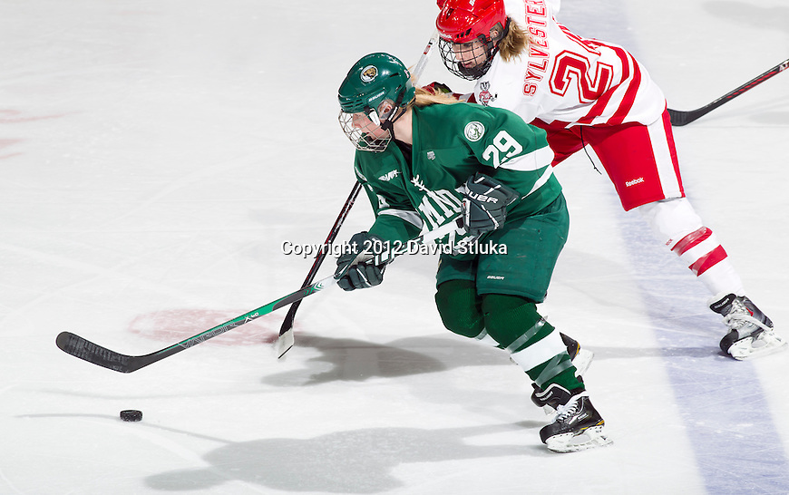 Bemidji State Beavers Kimberly Lieder (29) handles the puck against Wisconsin Badgers Karley Sylvester (24) during a WCHA Conference NCAA college women's hockey game on January 28, 2012 in Madison, Wisconsin. The Badgers won 1-0. (Photo by David Stluka)