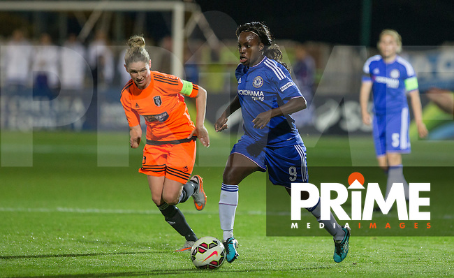 Eniola Aluko of Chelsea Ladies heads forward chased by Leanne Ross of Glasgow City during the UEFA Women's Champions League match between Chelsea Ladies and Glasgow City at Wheatsheaf Park, Staines, England on 8 October 2015. Photo by Andy Rowland.