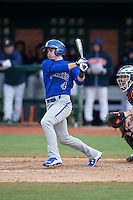 Mike Caputo (4) of the Seton Hall Pirates follows through on his swing against the Virginia Cavaliers at The Ripken Experience on February 28, 2015 in Myrtle Beach, South Carolina.  The Cavaliers defeated the Pirates 4-1.  (Brian Westerholt/Four Seam Images)