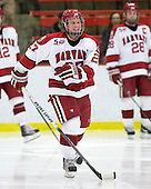 Michael Biega (Harvard - 27) - The Harvard University Crimson defeated the St. Lawrence University Saints 4-3 on senior night Saturday, February 26, 2011, at Bright Hockey Center in Cambridge, Massachusetts.