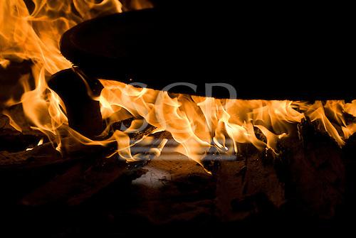 Aldeia Tanguro (Kalapalo), Mato Grosso State, Brazil. Beju pan on the fire.
