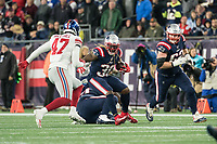 FOXBORO, MA - OCTOBER 10: New England Patriots Runningback Brandon Bolden (38) faces New York Giants Linebacker Alec Ogletree (47) during a game between New York Giants and New England Patriots at Gillettes on October 10, 2019 in Foxboro, Massachusetts.