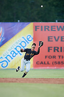 West Virginia Black Bears left fielder Sandy Santos (27) catches a shallow fly ball during a game against the Batavia Muckdogs on June 26, 2017 at Dwyer Stadium in Batavia, New York.  Batavia defeated West Virginia 1-0 in ten innings.  (Mike Janes/Four Seam Images)