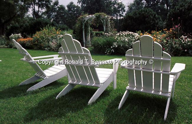 Three white chairs in garden Commonwealth of Virginia,