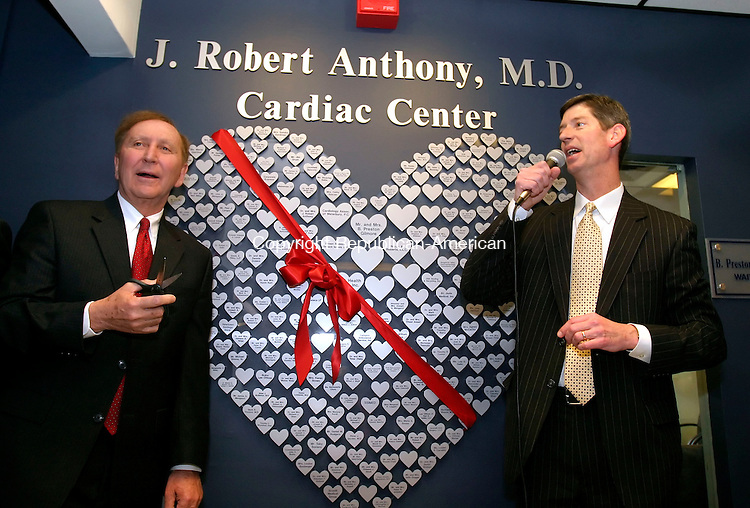 WATERBURY, CT--27 MARCH 2007--032707JS04- J. Robert Anthony, M.D., left, prepares to cut the ribbon as Saint Mary's Hospital President and Chief Executive Officer Robert Ritz, right, speaks during a dedication and blessing ceremony of the J. Robert Anthony, M.D. Cardiac Center Tuesday at Saint Mary's Hospital in Waterbury. Dr. Anthony was honored as the 2006 St. Mary's Hospital Champion and more than $500,000 was raised for the center. <br /> Jim Shannon / Republican-American