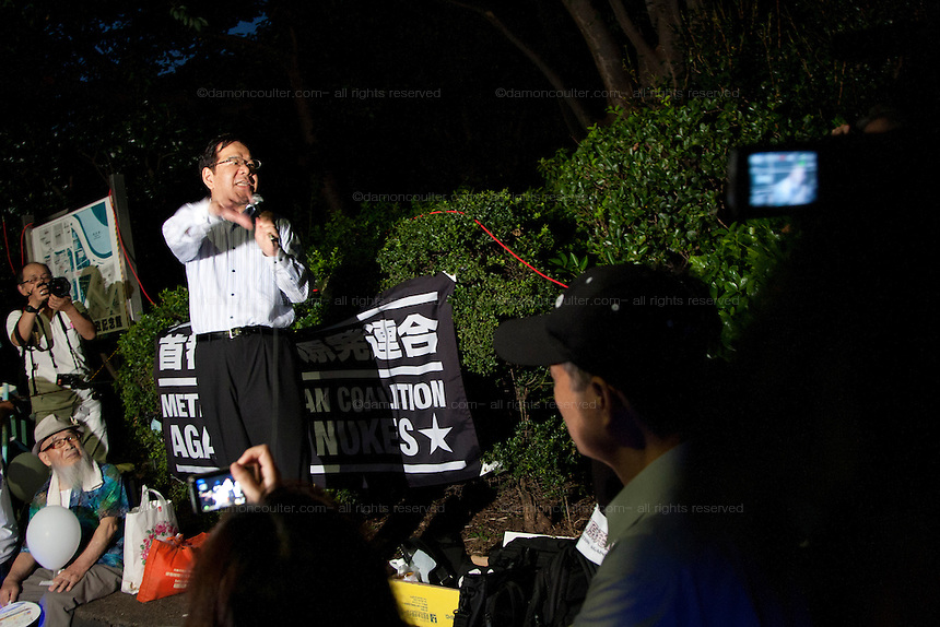 Leader of the Japanese Communist Party, Shii Kazuo speaks to several thousand people gathered outside the Prime Minister's house and in front of the Diet building in Tokyo to protest against nuclear power. Nagatacho Tokyo, Japan. Friday August 10th 2012. Protests have been held every Friday from 6pm to 8pm since March 2012 and participants have been growing in number as Prime Minister Noda carries out his policies of restarting Japan's nuclear reactors. All japan's nuclear reactors were shut down for safety checks after the Fukushima accident on March 11th 2011