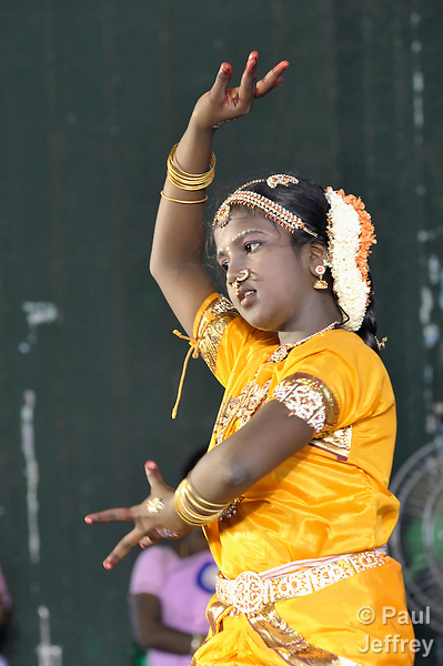 A young dancer in a rally celebrating International Women's Day in Madurai, a city in Tamil Nadu state in southern India.