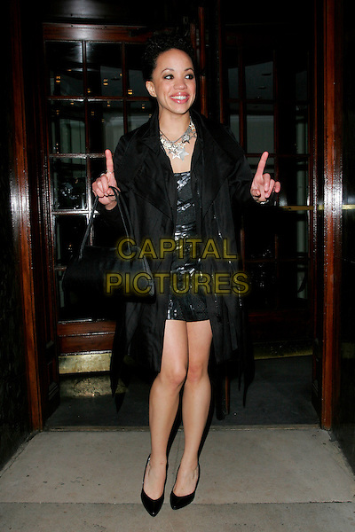 CAT SIMMONS.RTS Programme Awards 2007 - Arrivals, Grosvenor House, Park Lane, London, W1, England. .March 19 2008 .full length black dress jacket coat hands fingers pointing silver star necklace bag purse .CAP/AH.©Adam Houghton/Capital Pictures.