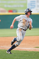 John Murphy (3) of the Charleston RiverDogs rounds third base against the Hickory Crawdads at L.P. Frans Stadium on May 25, 2014 in Hickory, North Carolina.  The RiverDogs defeated the Crawdads 17-10.  (Brian Westerholt/Four Seam Images)