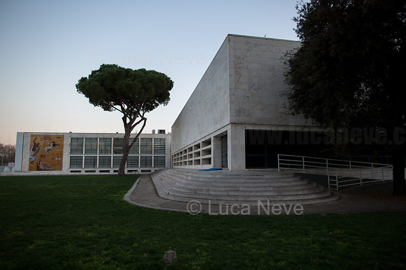 Foro Italico (it borders with Olympic Village).<br /> <br /> Rome, 16/03/20. Rome's Olympic Village district under the Italian Government lockdown for the Outbreak of the Coronavirus SARS-CoV-2 - COVID-19. On 22 March, the Italian PM Giuseppe Conte signed a new Decree Law which suspends non-essential industry productions and contains the list of allowed working activities, which includes Pharmaceutical & food Industry, oil & gas extraction, clothes & fabric, tobacco, transports, postal & banking services (timetables & number of agencies reduced), delivery, security, hotels, communication & info services, architecture & engineer, IT manufacturers & shops, call centers, domestic personnel (1.).<br /> Updates: Italy: 22.03.20, 6:00PM: 46.638 positive cases; 7.024 recovered; 5.476 died.<br /> <br /> The Rome's Olympic Village (1957-1960) was designed by: V. Cafiero, A. Libera, A. Luccichenti, V. Monaco, L. Moretti. «Built to host the approximately 8,000 athletes involved in the 1960 Olympic Games, Rome's Olympic Village is a residential complex located between Via Flaminia, the slopes of Villa Glori and Monti Parioli. It was converted into public housing [6500 inhabitants, ndr] at the end of the sporting event. The intervention is an example of organic settlement, characterized by a strong formal homogeneity, consistent with the Modern Movement's principles of urbanism. The different architectural structures are made uniform by the use of some common elements: the pilotis, ribbon windows, concrete stringcourses, and yellow brick curtain covering. At the center of the neighborhood, the Corso Francia viaduct - a road bridge about one kilometer long - was built by P.L. Nervi[…]» (2.).<br /> <br /> Info COVID-19 in Italy: http://bit.do/fzRVu (ITA) - http://bit.do/fzRV5 (ENG)<br /> 1. March 22nd Decree Law http://bit.do/fFwJn (ITA)<br /> 2. (Atlantearchitetture.beniculturali.it MiBACT, ITA - ENG) http://bit.do/fFw3H<br /> 12.03.20 Rome's Lockdown for the Outbreak of the Coro