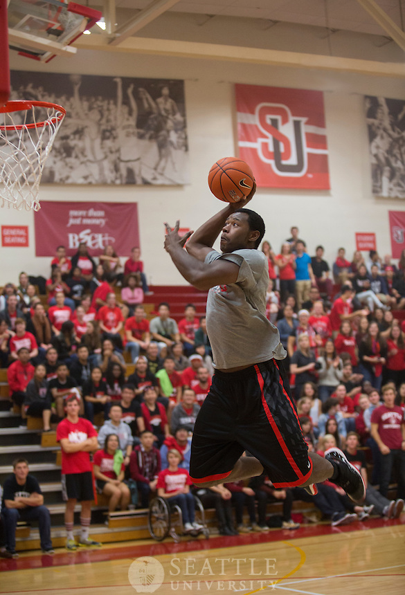 10182013- Clarence Trent goes up for a dunk during the dunk contest at Midnight Madness in Connolly's North Court.