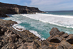 Waves breaking in a  small bay near Los Molinos, west coast of Fuerteventura, Canary Islands, Spain
