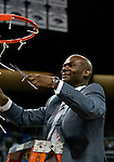 March 1, 2012: Nevada Wolf Pack head coach David Carter celebrates as he cuts down the net after the game against the  New Mexico State Aggies played at Lawlor Events Center on Thursday night in Reno, Nevada. Nevada (24-5, 12-1 WAC) won its fourth outright Western Athletic Conference title after defeating New Mexico State (22-9, 9-4 WAC) 65-61.