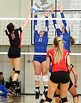 SIOUX FALLS, SD - NOVEMBER 5:  Abbie Sell #11 from Brookings tries to get the ball past Dalee Stene#17 and Kate Cartwright #16 from O'Gorman in the second game of their District 1AA game Tuesday night at O'Gorman (Photo by Dave Eggen/Inertia)