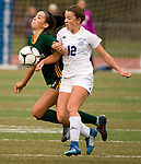 MIDDLETOWN, CT-111817JS32- Holy Cross' Adalisse Padilla (10) gets knocked down by Old Lyme's Mya Johnson (12) as they both go for the ball during their Class S state final game Saturday at Middletown High School.<br /> Jim Shannon Republican-American