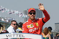 March 17, 2019: Sebastian Vettel (DEU) #5 from the Scuderia Ferrari team waves to the crowd during the drivers parade prior to the start of the 2019 Australian Formula One Grand Prix at Albert Park, Melbourne, Australia. Photo Sydney Low