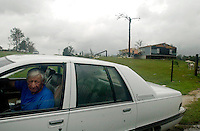 BLOUNTSTOWN, FL. 9/16/04-Robert Hartzell looks out his car window as he leaves his home Thursday near Blountstown. Hartzell's home was damaged by a tornado spawned by Hurricane Ivan Wednesday night. While he and his family escaped serious injury, four of their neighbors were killed by the twister. COLIN HACKLEY PHOTO