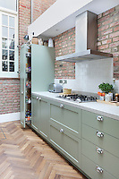 Kally Ellis's bespoke Shaker-style kitchen. A Metro style splashback makes a great partner to the smart and durable polished concrete worktop surounding the stainless-steel Miele hob