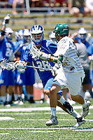 April 30, 2011:  Duke Blue Devils defender Jimmy O'Neill (28) runs up field while being guarded by a Jacksonville defender during lacrosse action between the Duke Blue Devils and Jacksonville Dolphins at D. B. Milne Field in Jacksonville, Florida.  Duke defeated Jacksonville 10-6.